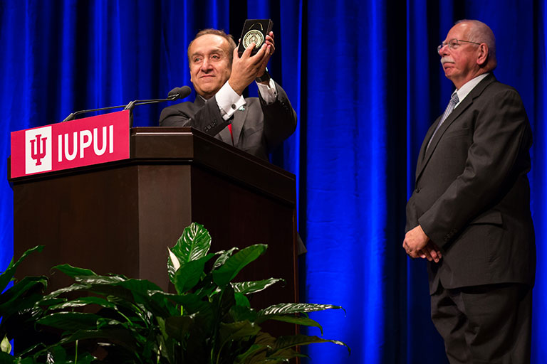 William Plater received the Chancellor's Medallion from IUPUI Chancellor Nasser H. Paydar
