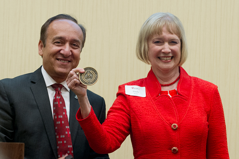Trudy Banta receiving the Chancellor's Medallion