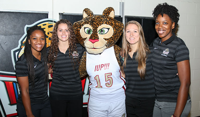 Jazzy with members of the IUPUI Women's Basketball Team at Basketball Tipoff Luncheon