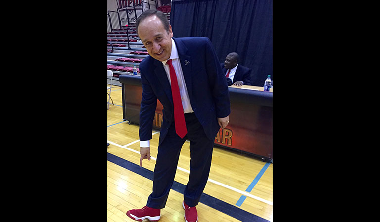 IUPUI Chancellor Nasser H. Paydar rocks it in red shoes at the Basketball Tipoff Luncheon