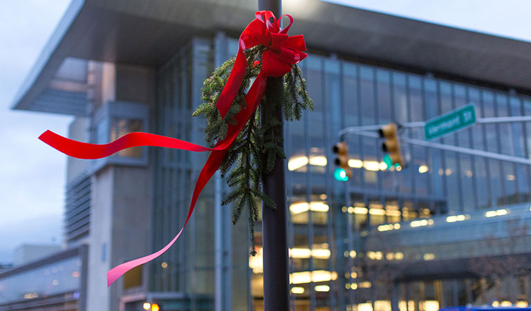 Installing holiday wreaths at IUPUI