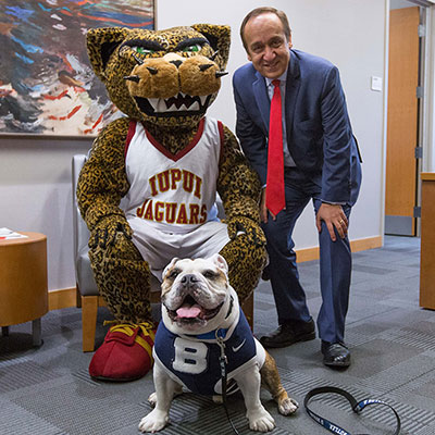 Butler Blue with the IUPUI jaguar and Chancellor Paydar