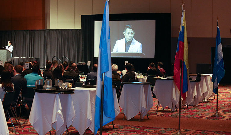Guests and the presentation at the 9th Annual IUPUI Cesar Chavez Celebration Dinner