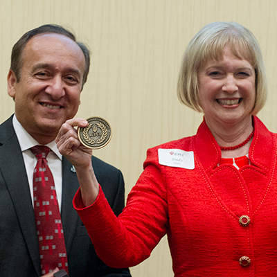 Chancellor Paydar and Trudy Banta with her award
