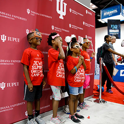 Kids at a photo boot at the Indiana Black Expo Summer Celebration.