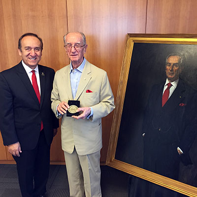 Chancellor Nasser H. Paydar stands with Dean Emeritus R. Bruce Renda with his Chancellor's Medallion.
