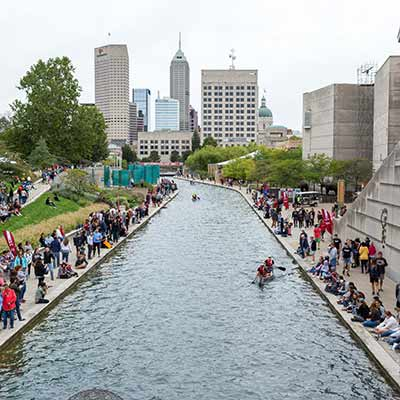 View of the 2018 IUPUI Regatta from the Blackford Street bridge with the Indianapolis Skyline in the background.