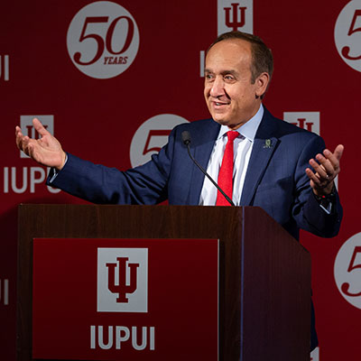 IUPUI Chancellor Nasser H. Paydar speaks at a podium during the 2018 Alumni Trustee reception.