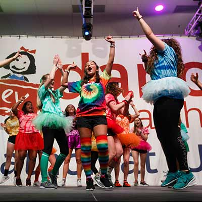 Students dance onstage during the 2019 Jagathon Dance Marathon.