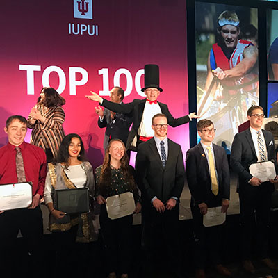 IUPUI's Top 100 students line up on stage to be recognized.