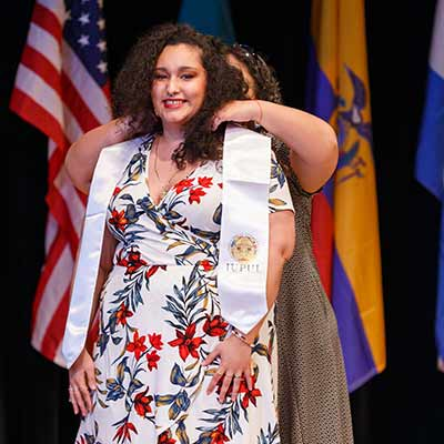 A woman receives her Latinx stole at the Latinx Graduation Celebration.