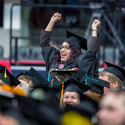 A student cheers at the 2019 IUPUI Commencement Ceremony.