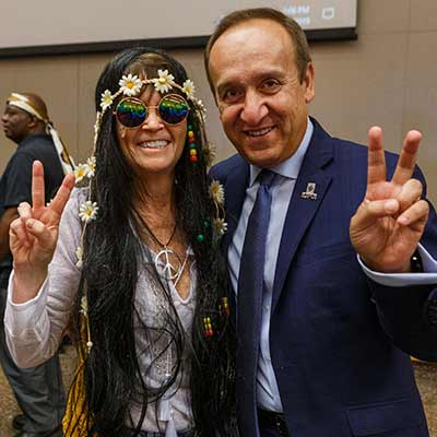 IUPUI Chancellor Nasser Paydar flashes a peace sign with the winner of the costume contest.