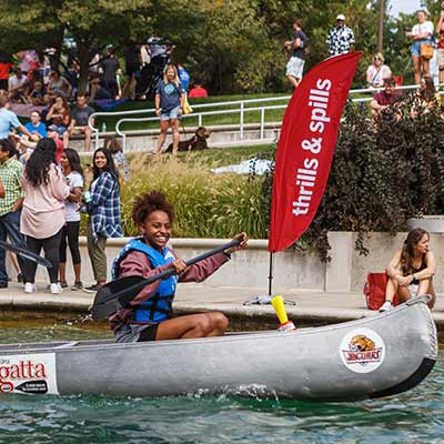 A student rows in the 11th Annual IUPUI Regatta canoe race.