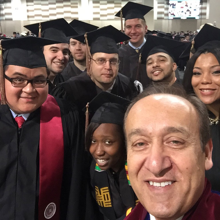Chancellor Paydar with graduates at Commencement