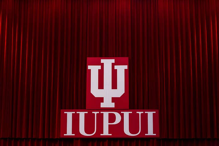 The IUPUI logo on the stage at commencement.