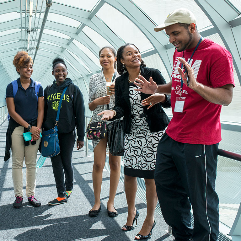Students in a pedestrian tube on campus