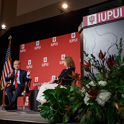 IUPUI Chancellor Nasser H. Paydar chats onstage with IU Trustee MaryEllen Bishop at the 2020 Report to Community.