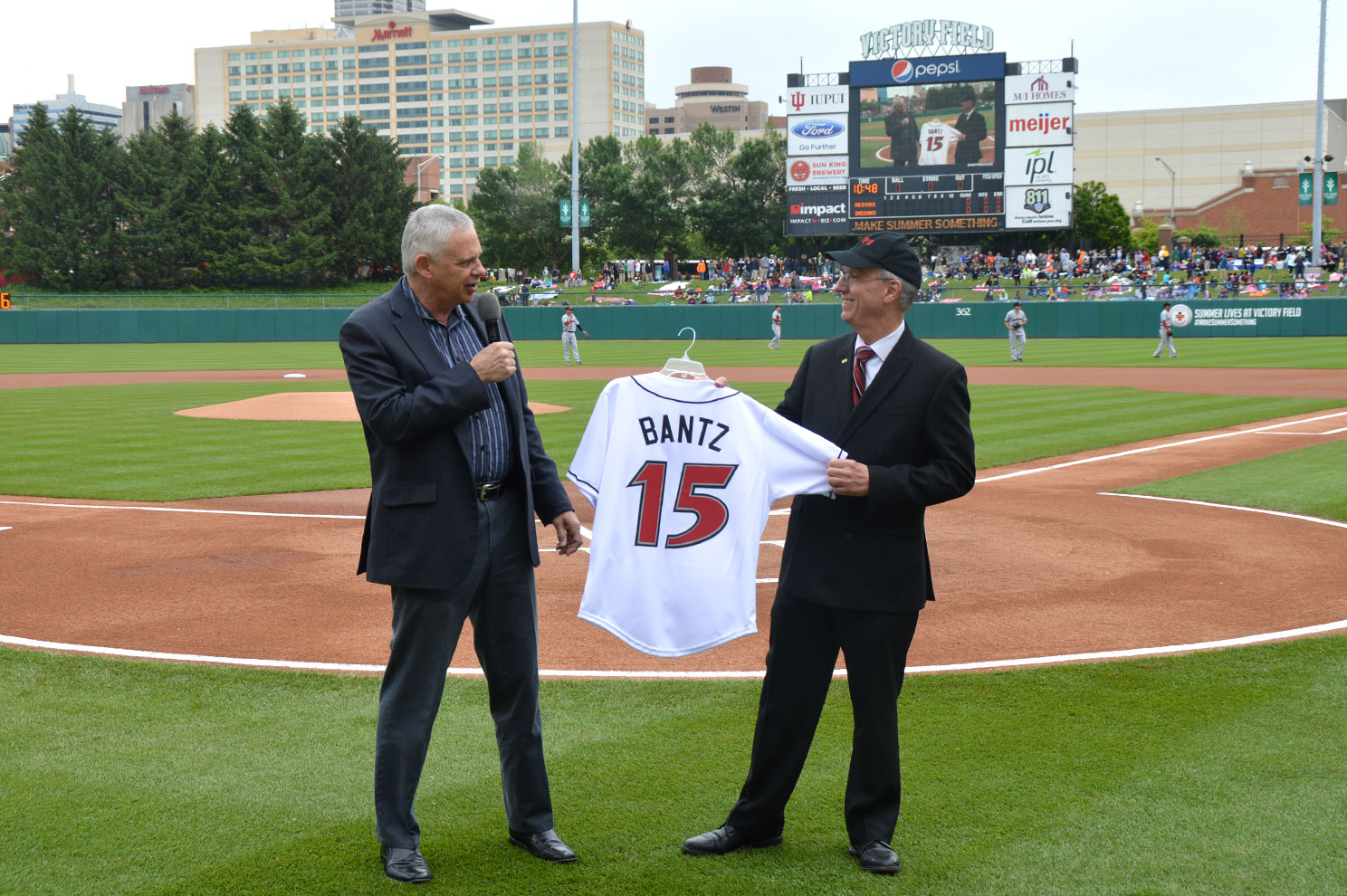 Carl Burleson present Chancellor Bantz with an Indianapolis Indians jersey.