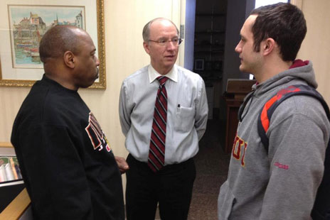 Chancellor Bantz talks with a student and Dean Davenport.